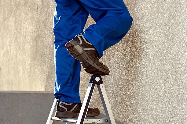 Travailleur de la Construction sur échelle - Photo