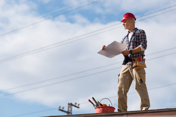 Construction worker on rooftop stock photo