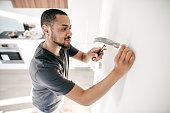A man doing simple repairs.