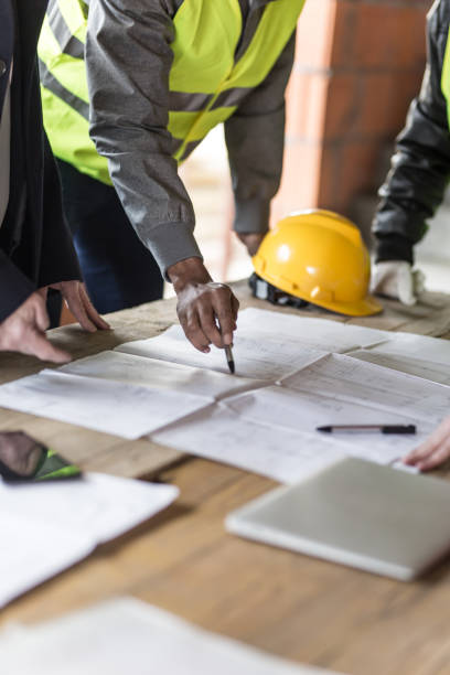 Construction worker Housing projects - blueprint - finger pointing public housing stock pictures, royalty-free photos & images
