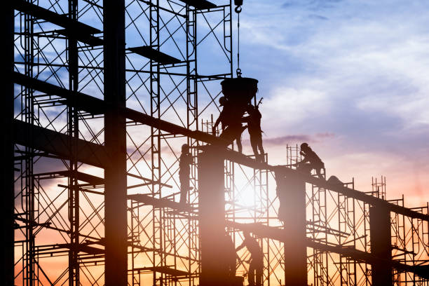 Construction worker. Silhouette of worker. Construction Building casting concrete work on scaffolding. scaffolding stock pictures, royalty-free photos & images