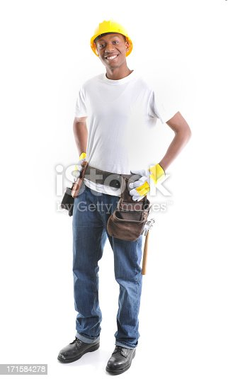 A young African American man wearing construction gear.