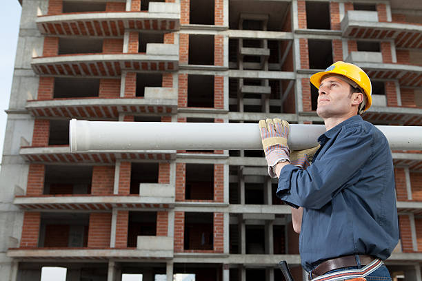 Construction Worker Construction worker working in construction site. pipefitter stock pictures, royalty-free photos & images