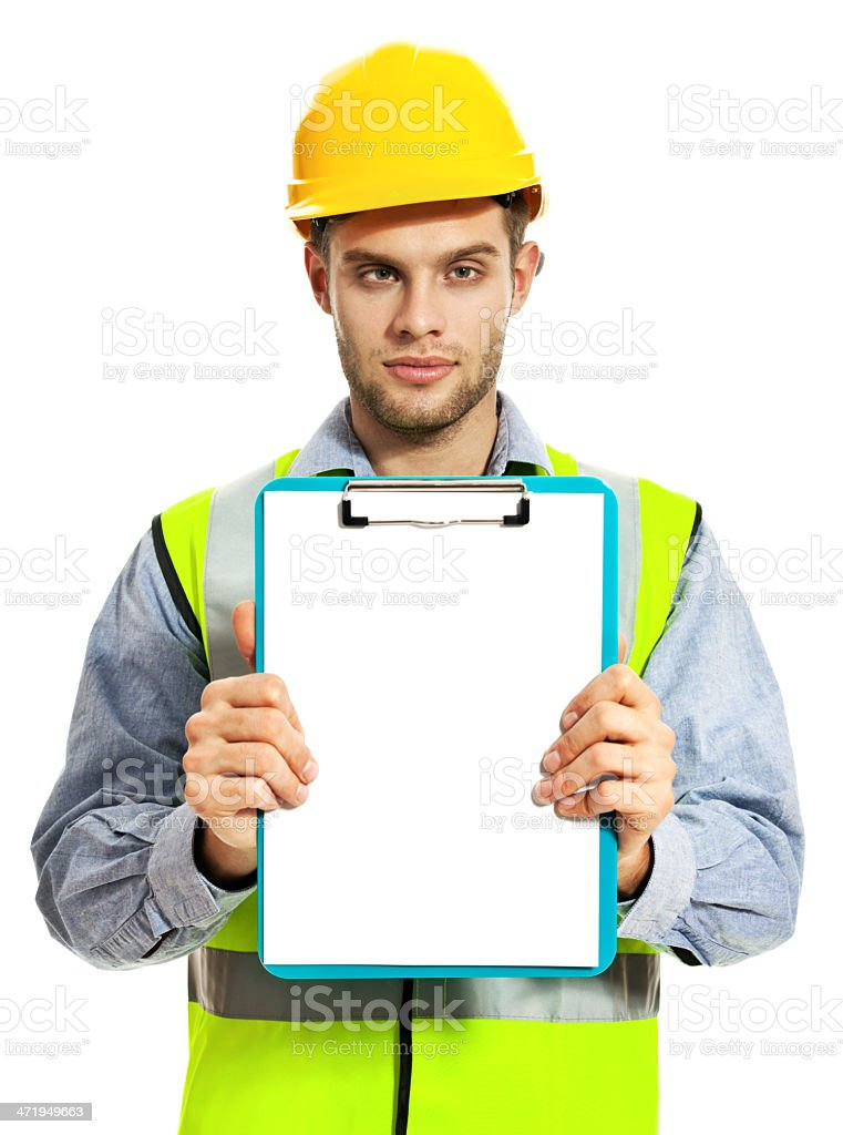 Construction Worker Portrait of  young construction worker wearing hardhat and reflective vest, holding clipboard against and looking at camera. Studio shot, white background. 20-29 Years Stock Photo