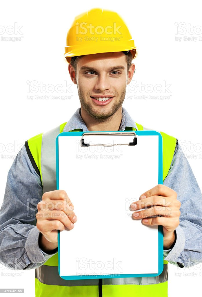 Construction Worker Portrait of young construction worker wearing hardhat and reflective vest, holding clipboard and smiling at camera. Studio shot, white background. 20-29 Years Stock Photo