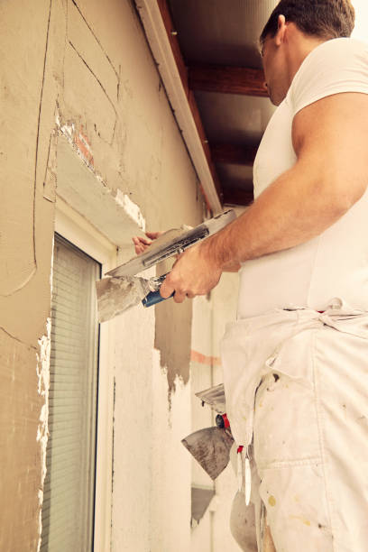 Construction worker plastering wall. stock photo