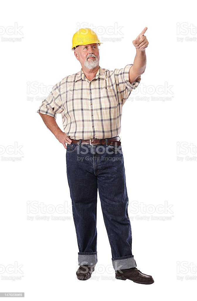 Construction worker pointing ahead royalty-free stock photo