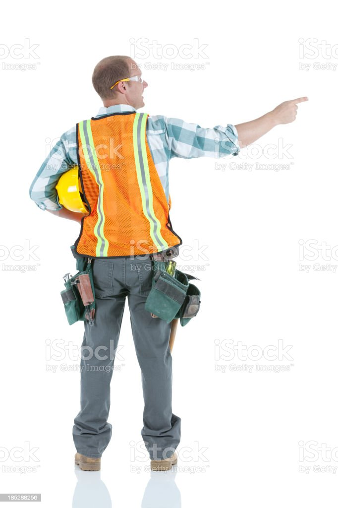 Construction worker pointing royalty-free stock photo
