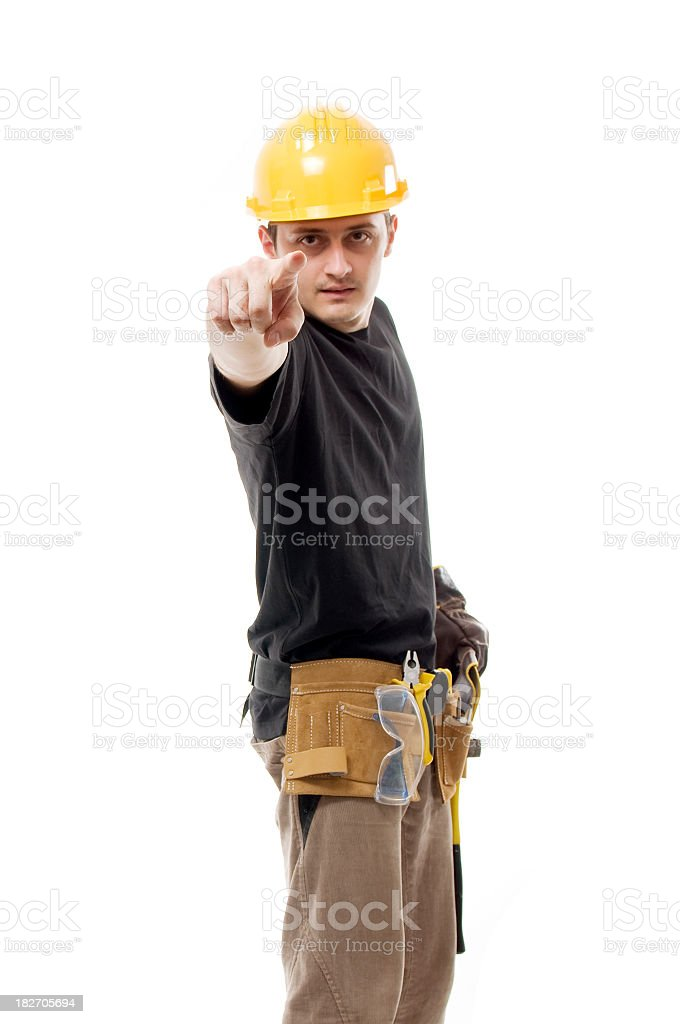 Construction worker pointing to the camera royalty-free stock photo