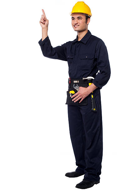Construction worker pointing upwards stock photo