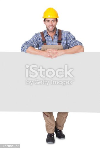 istock Construction worker presenting empty banner 177855277