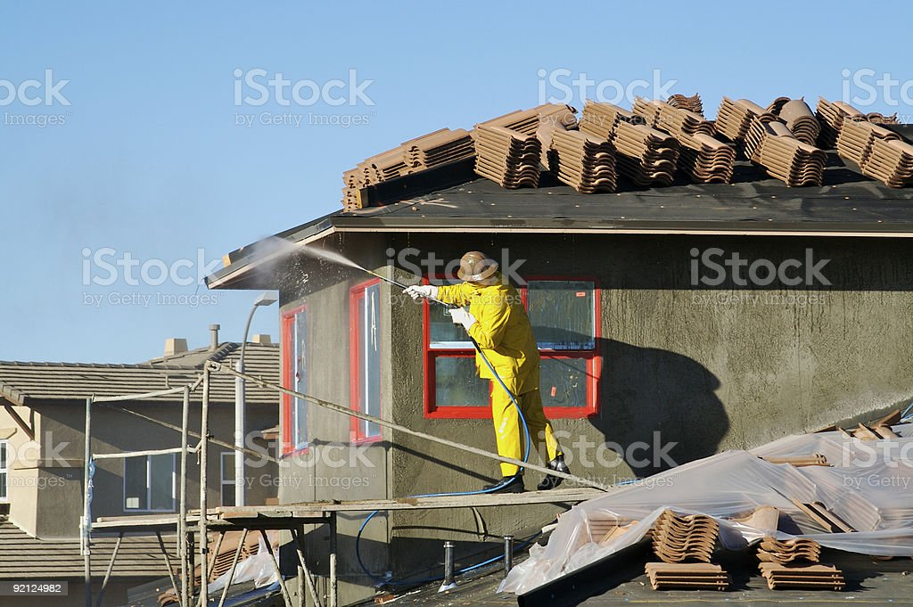 Construction Worker Pressure Washes royalty-free stock photo