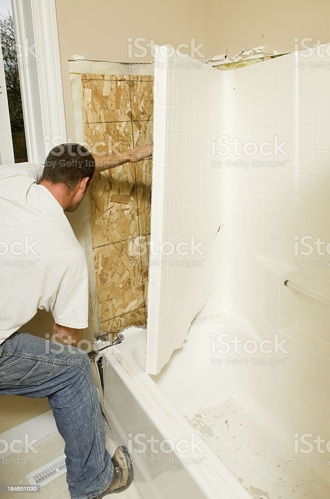 https://media.istockphoto.com/photos/construction-worker-removing-a-fiberglass-bathtub-picture-id184651030