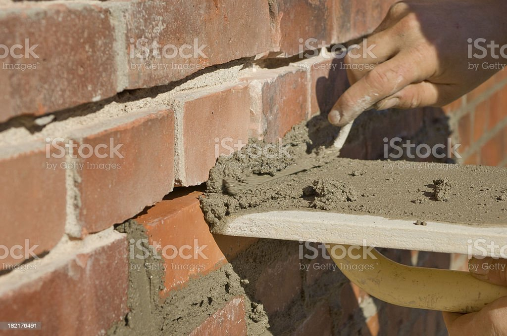 Construction Worker Repointing Old Bricks With New Cement stock photo