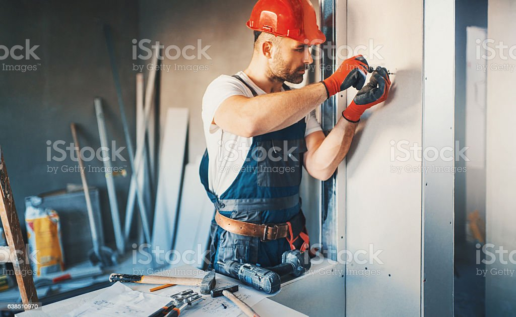 Construction worker routine. stock photo