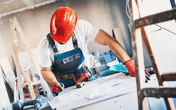 Construction worker routine. - foto de acervo