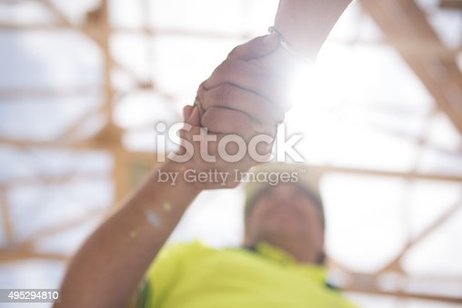 istock Construction worker shaking hands with manager 495294810