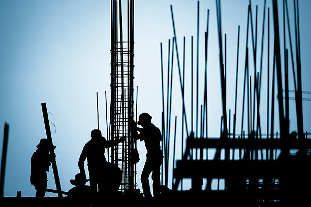 construction worker silhouette on the work place construction worker silhouette on the work place rod stock pictures, royalty-free photos & images