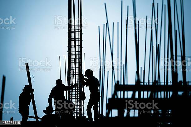 Construction Worker Silhouette On The Work Place Stock Photo - Download Image Now
