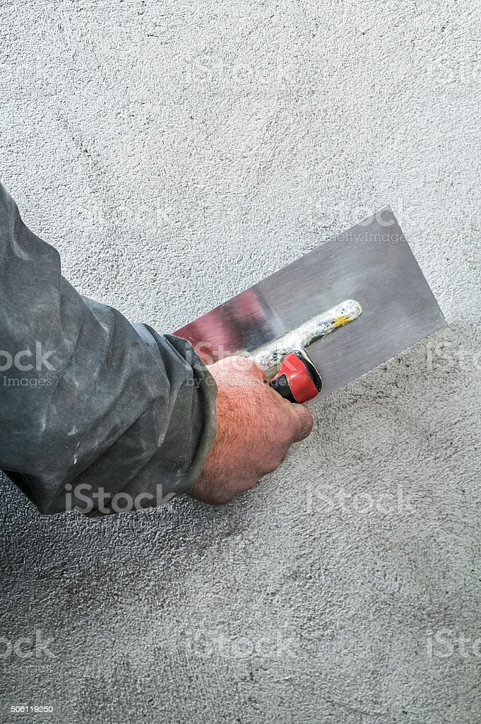 Construction worker smoothing - plastering concrete wall stock photo