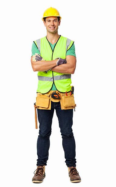bau arbeiter stehend arme verschränkt - legere arbeitskleidung stock-fotos und bilder