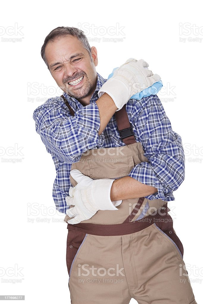 Construction Worker Suffering With Shoulder Pain stock photo