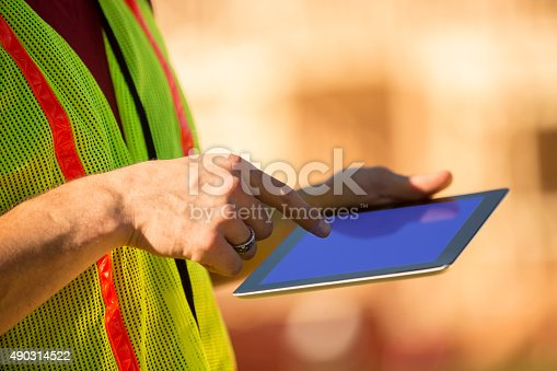 994878714 istock photo Construction worker, supervisor inspects work at building site. Digital tablet. 490314522