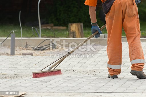 istock Construction worker sweeping 610143330