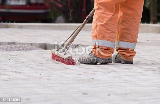 istock Construction worker sweeping 610144084