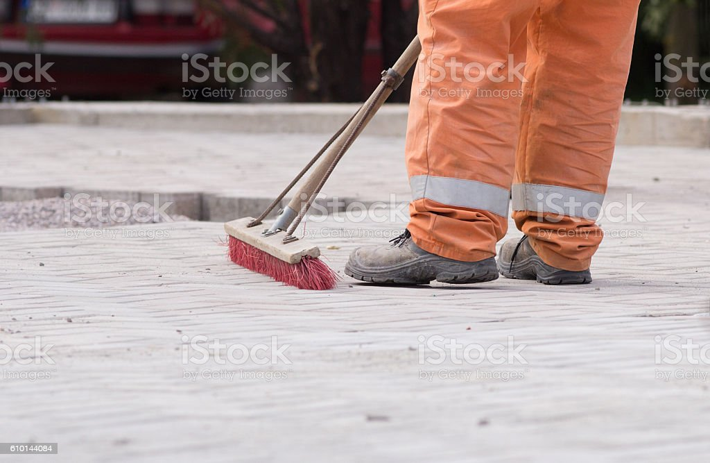 Construction worker sweeping stock photo