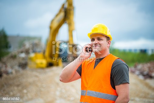 istock Construction worker takes a call 665414152