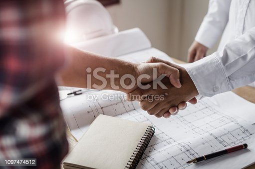 istock construction worker team hands shaking after consultation meeting to greeting start up plan new project contract in office center at construction site, teamwork, partnership and contractor concept 1097474512