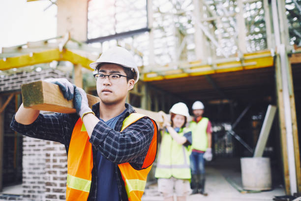 Construction worker team portrait looking at camera. SydneyConstruction. Construction worker team portrait looking at camera. construction worker stock pictures, royalty-free photos & images