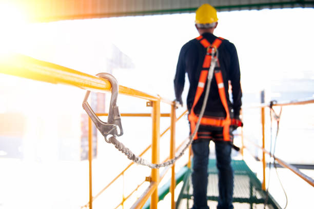 construction worker use safety harness and safety line working on a new construction site project. - tall high stock pictures, royalty-free photos & images