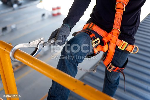 istock Construction worker use safety harness and safety line working on a new construction site project. 1036795714