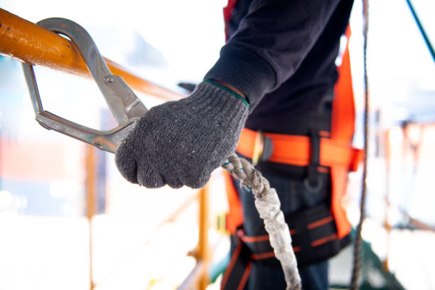 construction worker use safety harness and safety line working on a new construction site project. - fall prevention stock photos and pictures