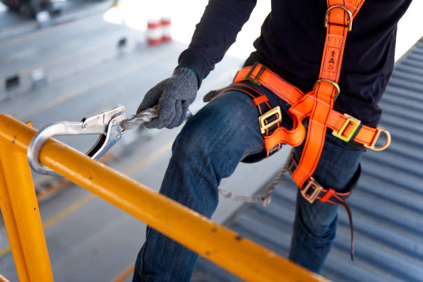 construction worker use safety harness and safety line working on a new construction site project. - protezione foto e immagini stock