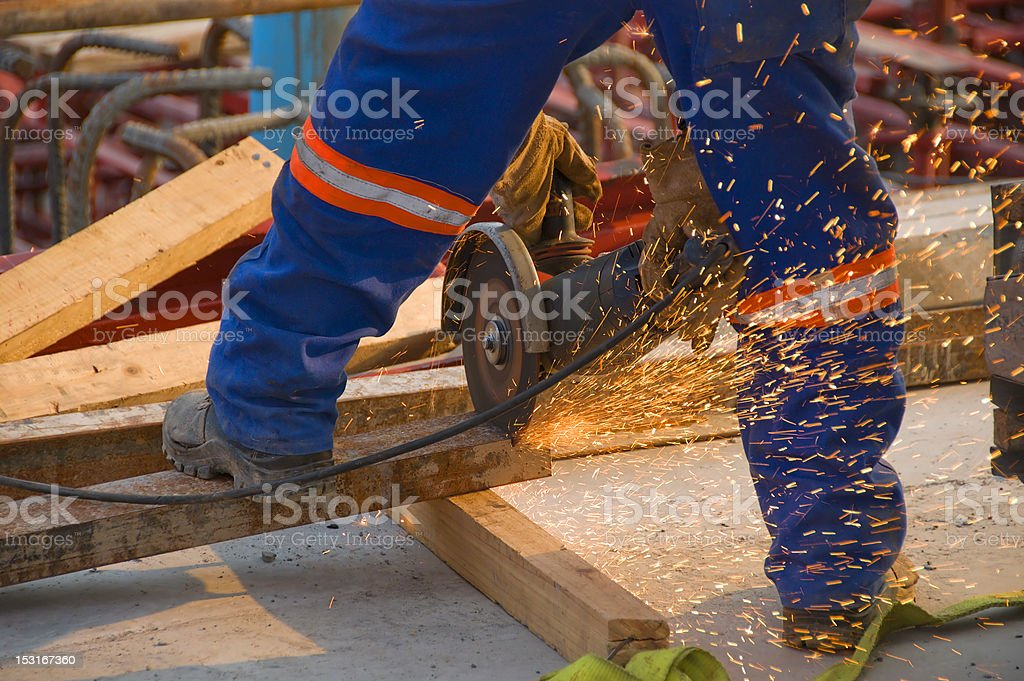 Construction worker using an angle grinder royalty-free stock photo