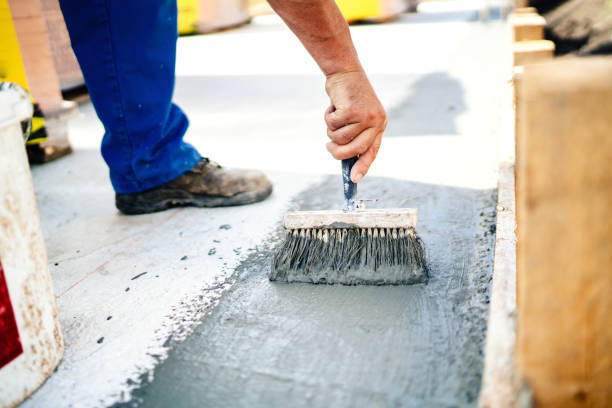construction worker using brush and primer for hydroisolating and waterproofing house stock photo