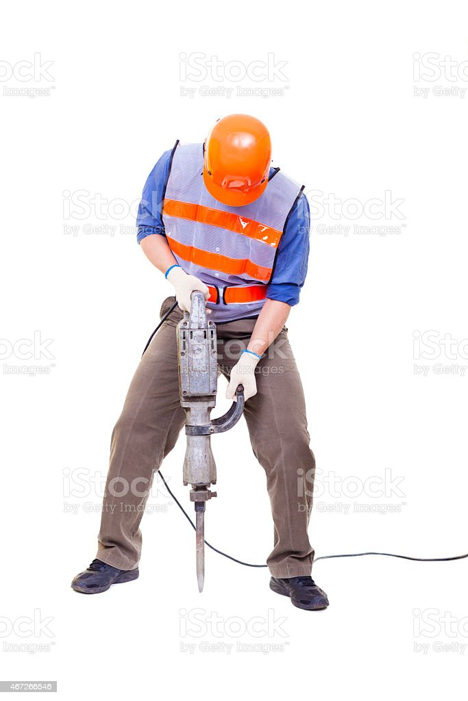 Construction worker using drill equipment on a white surface stock photo