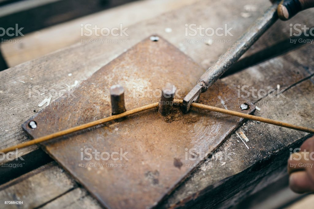 construction worker using industrial tools for bending clamp on construction site stock photo