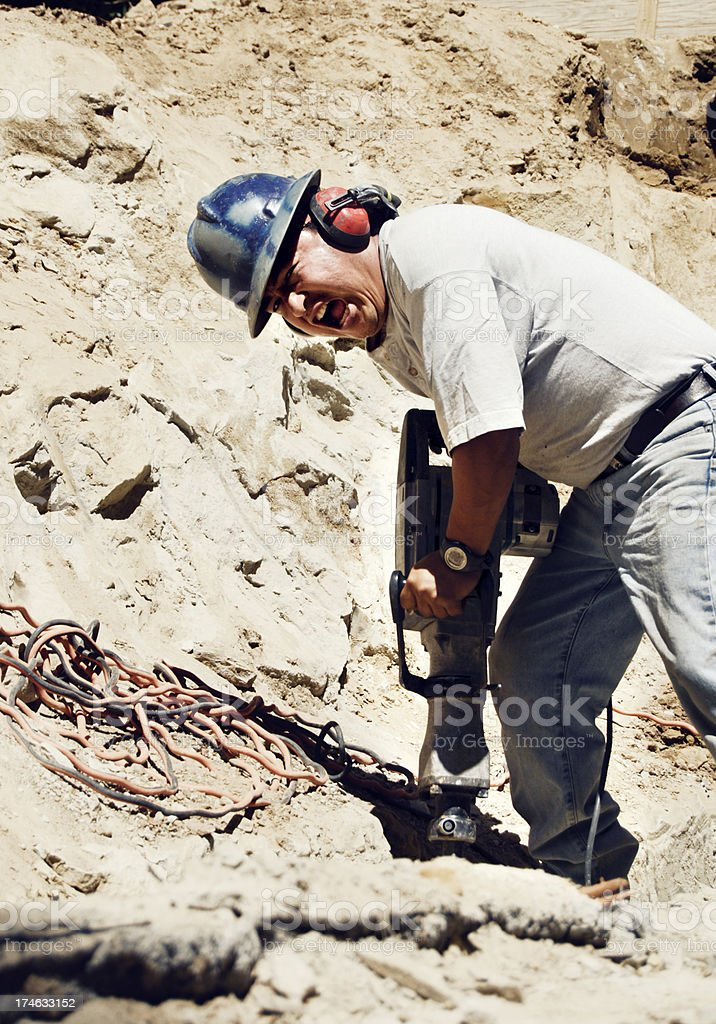 Construction worker using jack hammer stock photo