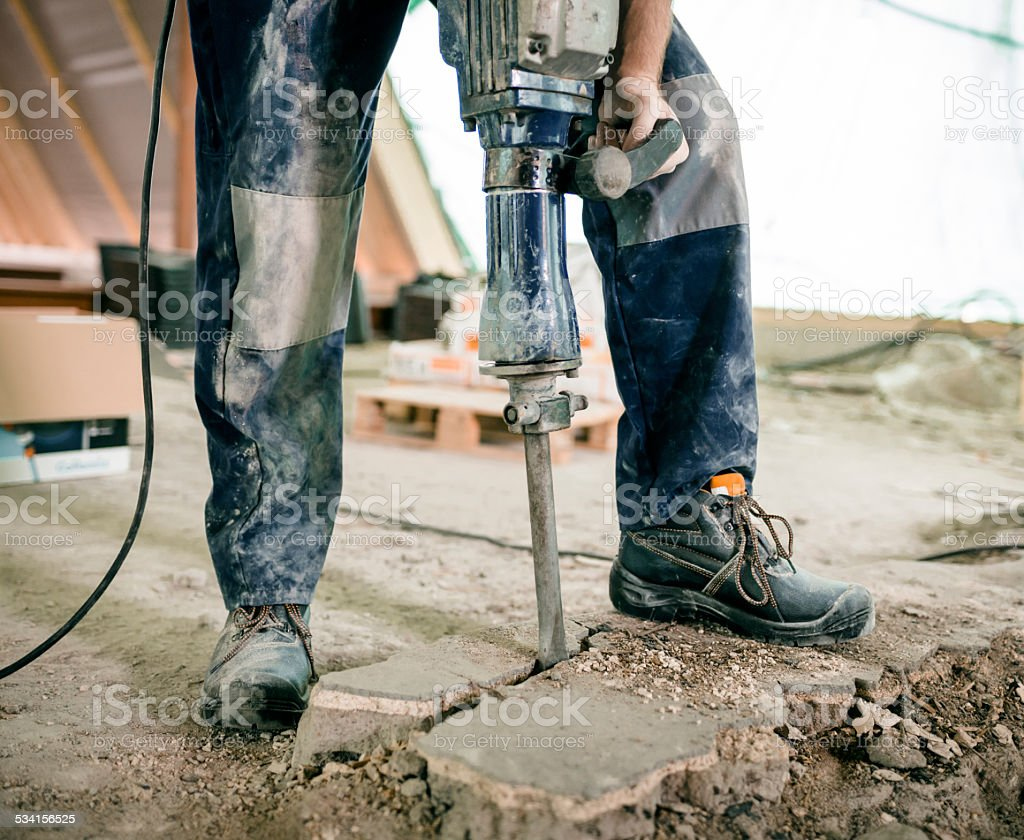 Construction Worker Using Jackhammer stock photo