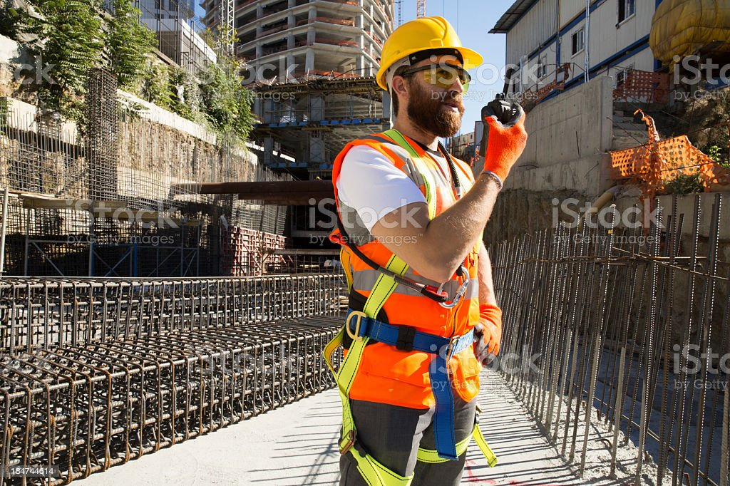 Construction worker using radio for communication on-site stock photo
