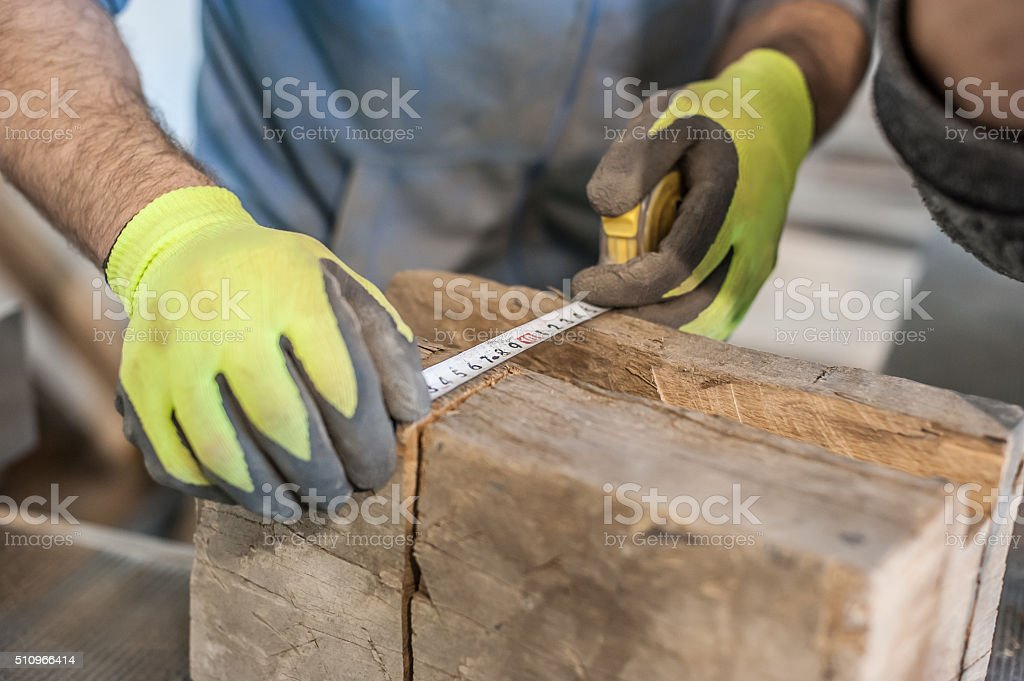 Construction Worker Using Tape Measure stock photo