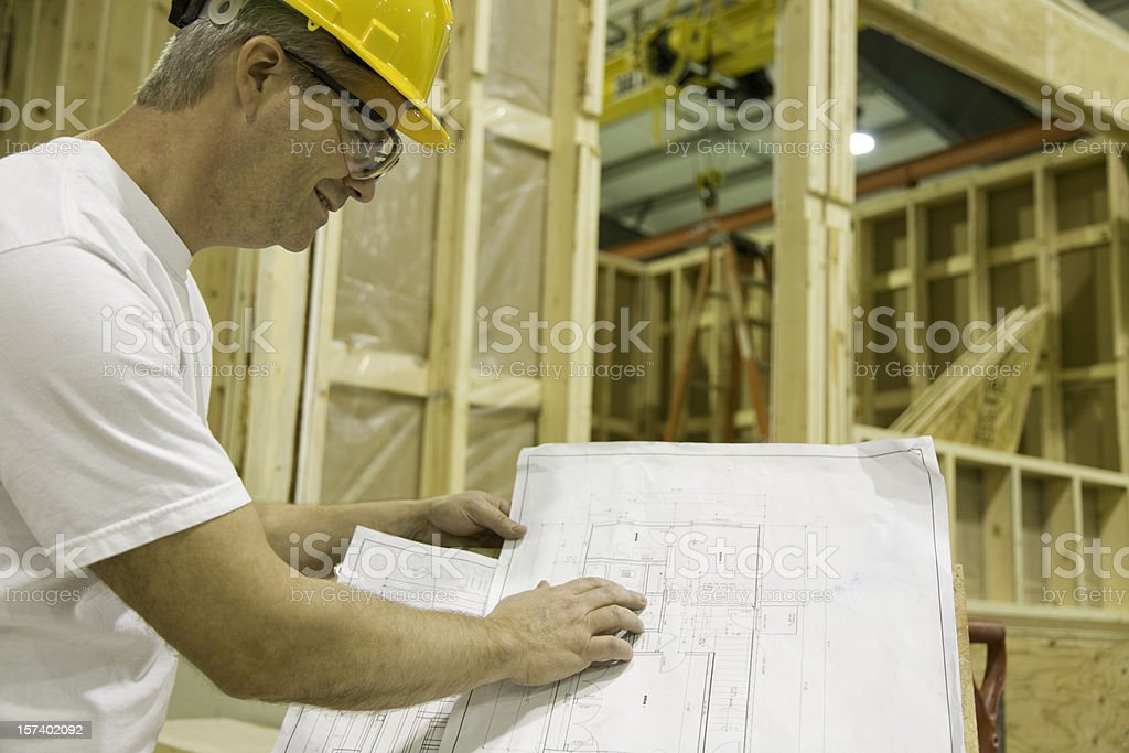 Construction worker viewing blueprints royalty-free stock photo