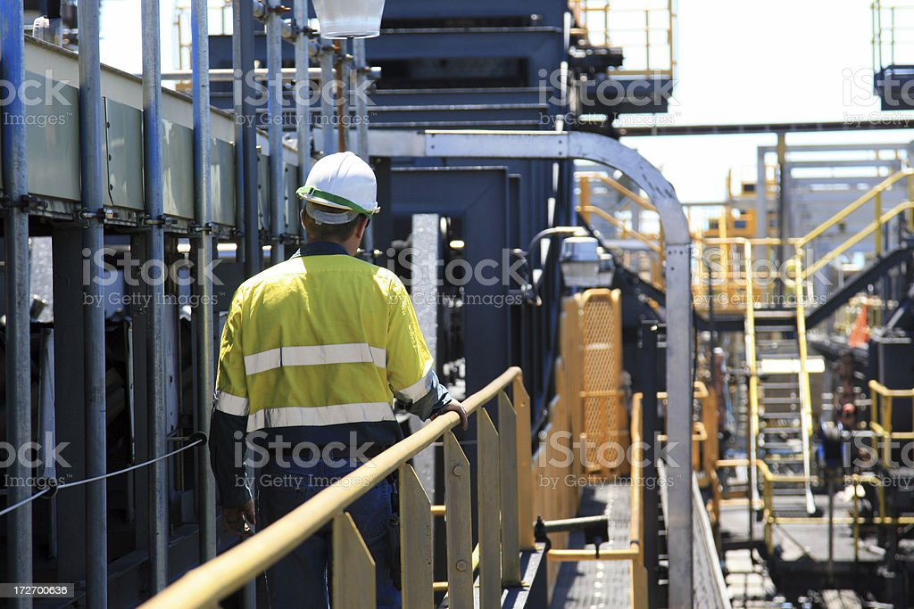 Construction Worker Walking Away stock photo