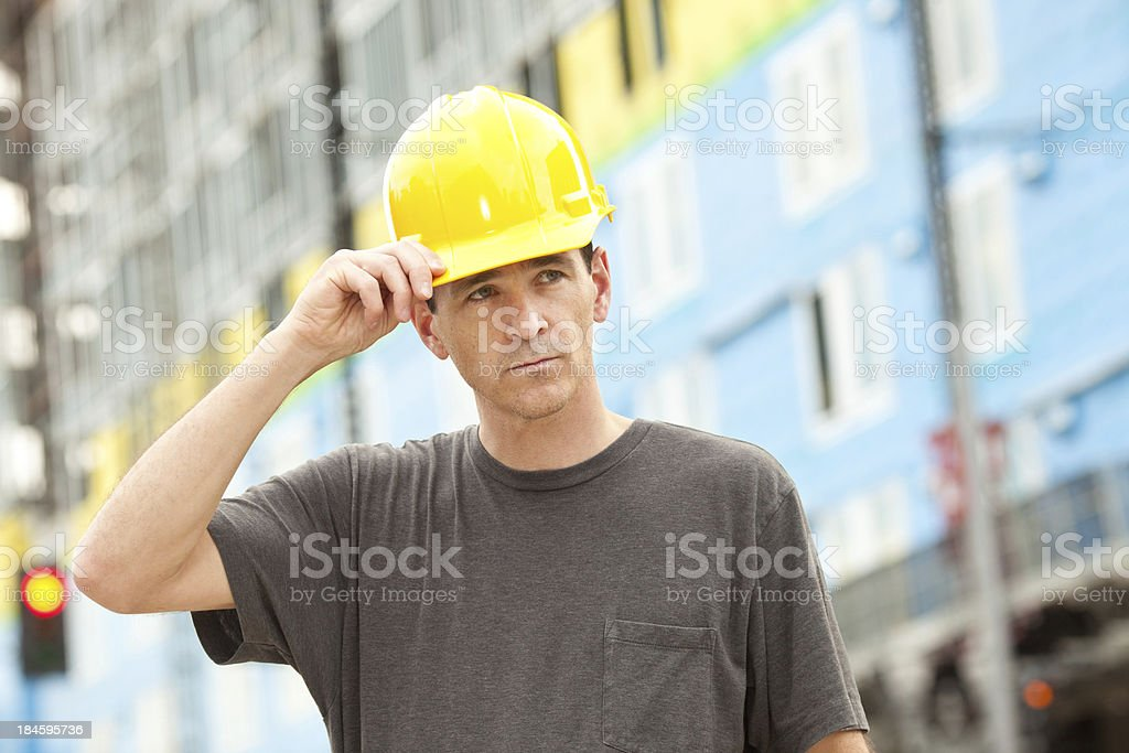 Construction Worker Wearing a Hard Hat royalty-free stock photo