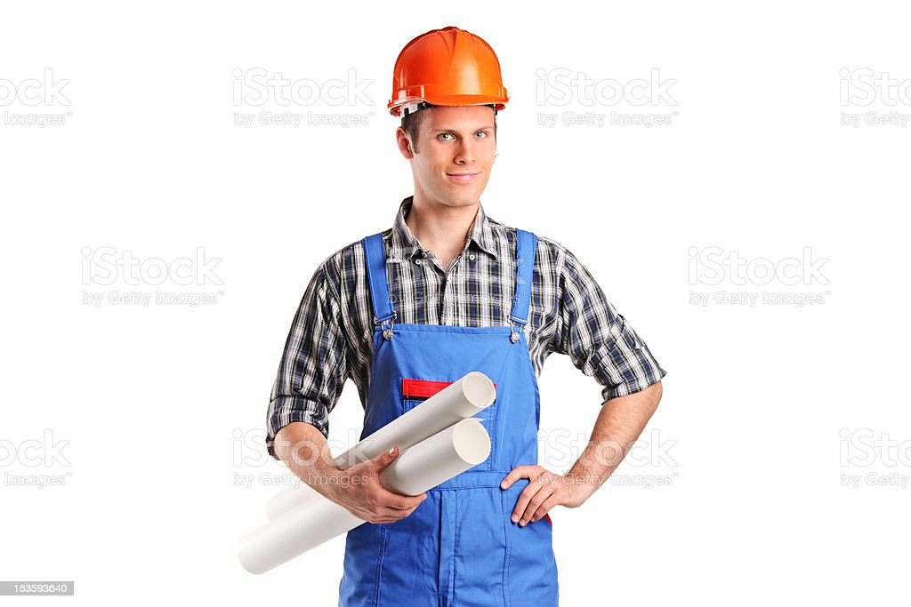 Construction worker wearing helmet and holding blueprints stock photo