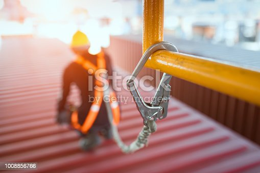 istock Construction worker wearing safety harness and safety line 1008856766